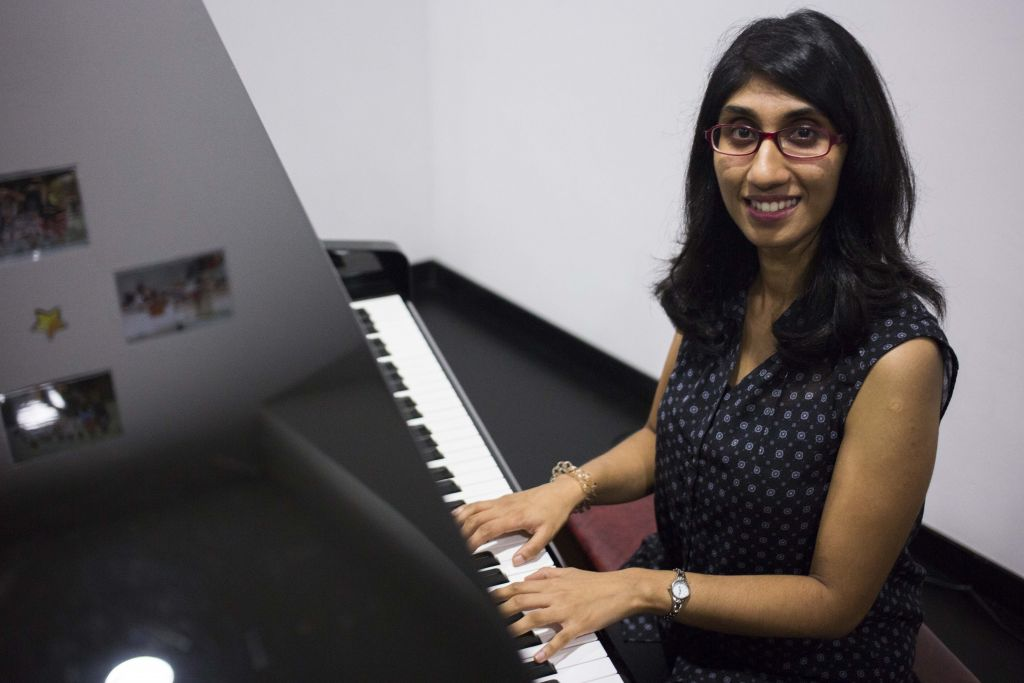 Deaf in one ear, part-time piano teacher aims to get a diploma in 2018