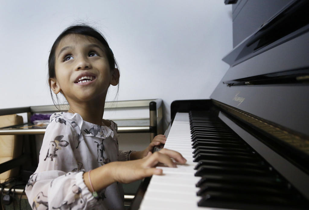 Anisah, the blind keyboard player who brings joy and laughter to her family