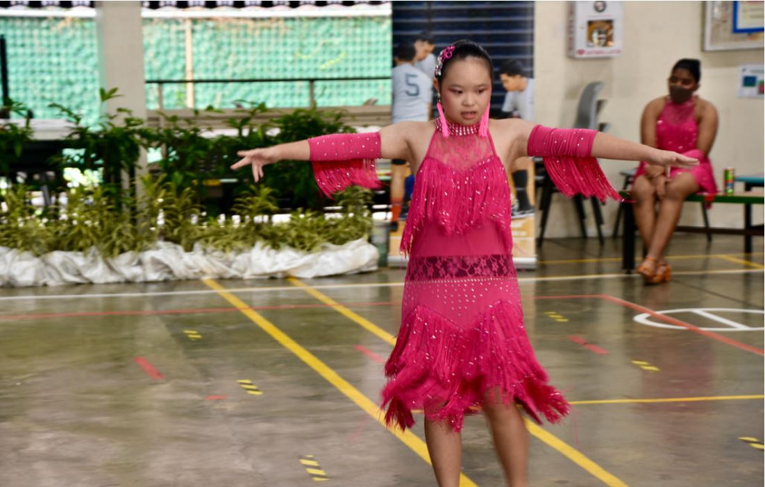 Photo shows Megan Tang, one of the Goh Chok Tong Enable Awards (UBS Promise) awardees dancing.