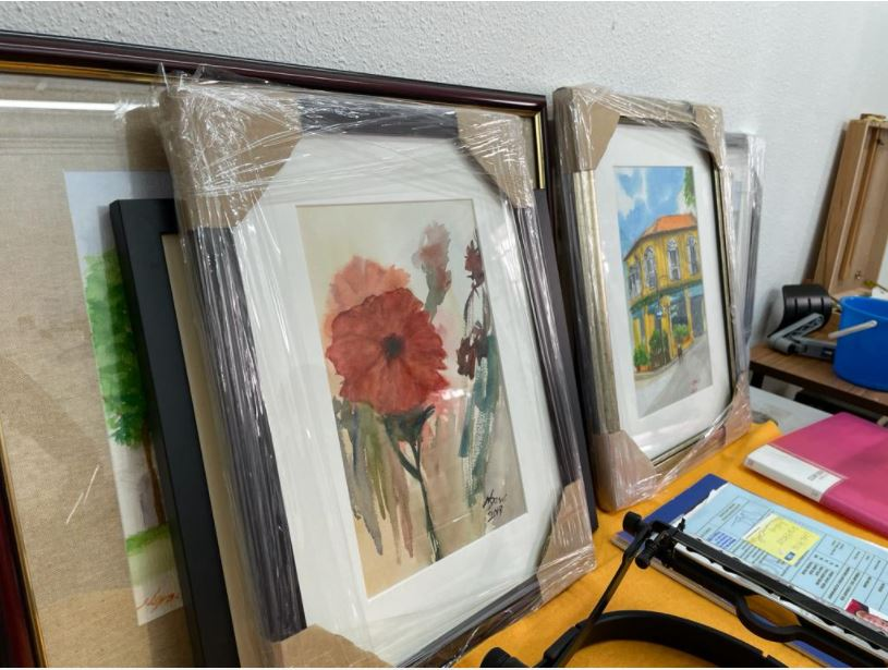 Photo shows some paintings painted by Mr William Ngo who uses his mouth to hold the brushes.